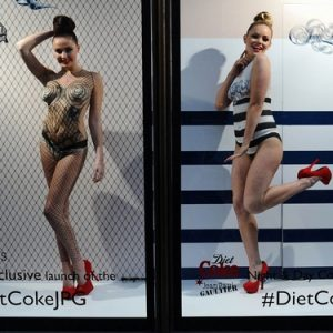 Body painted models posing in the window at Harvey Nichols