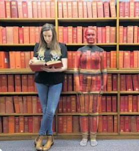 Camouflage body painting in library
