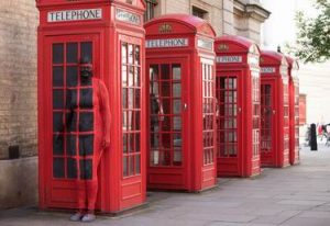 Telephone box camouflage body painting